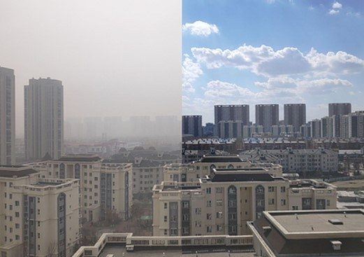 Photo of city with poor air quality on left, clean air on the right.