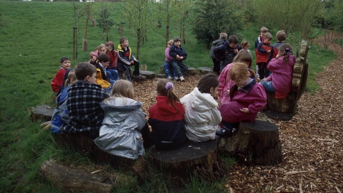 Students sitting in a camping circle