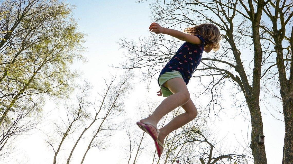 Child jumping through the air