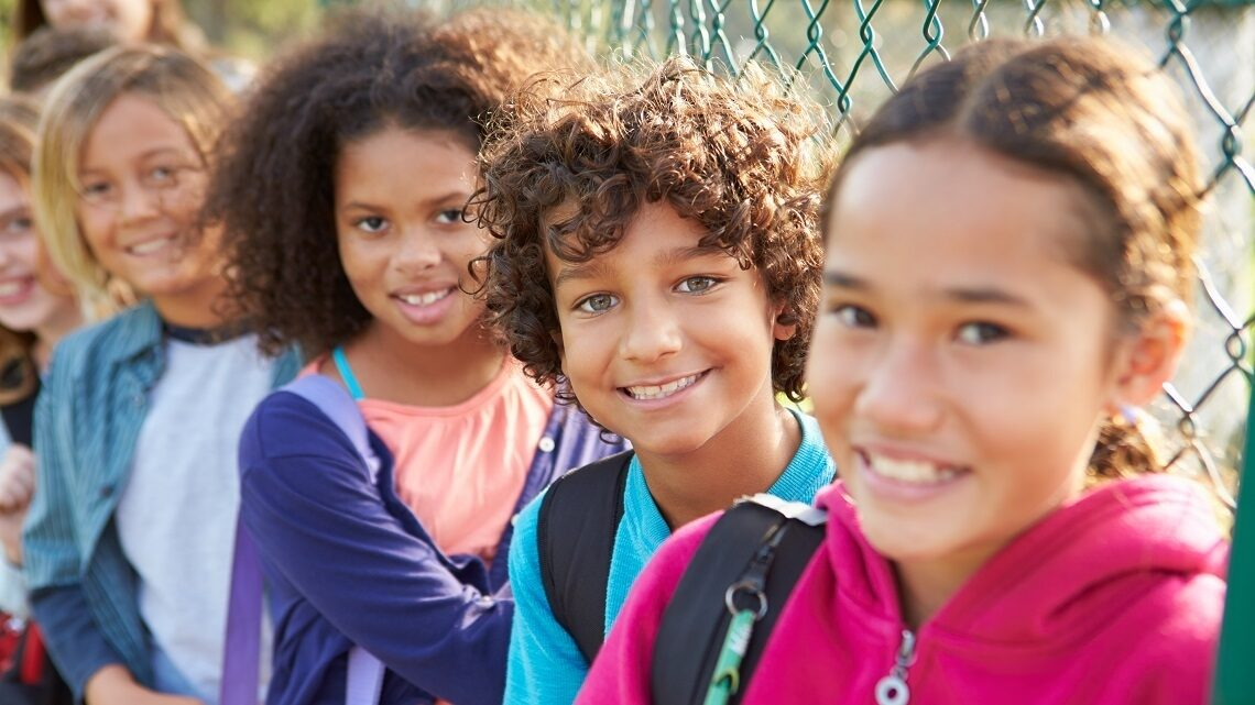 Young school children smiling