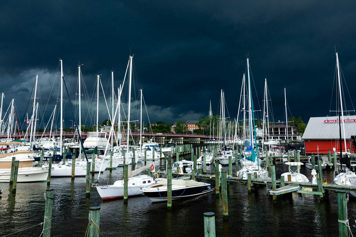 Dark storm clouds form over the water