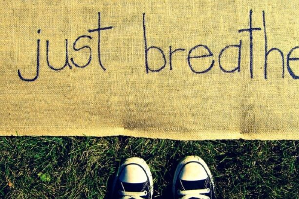 "Child standing in front of a mat saying ""just breath"""