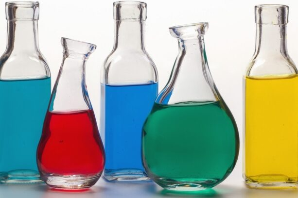 Colorful liquids in bottles representing chemicals