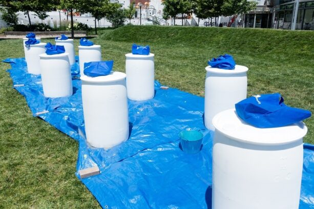Rain barrels wait to be painted
